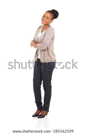 cheerful african girl with arms crossed looking at the camera - stock photo