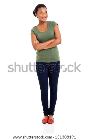cheerful african girl with arms crossed looking up - stock photo