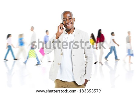 Cheerful African Man Talking On a Mobile Phone With Busy Background - stock photo
