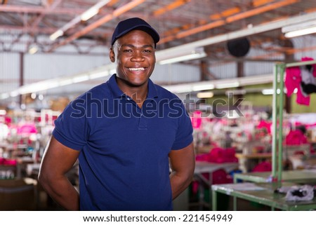 cheerful african textile worker looking at the camera