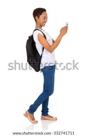 cheerful african university student using smart phone isolated on white background - stock photo