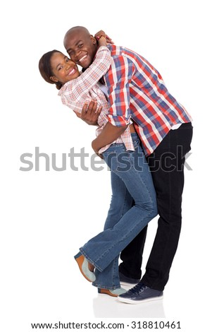 cheerful afro american couple hugging isolated on white background - stock photo