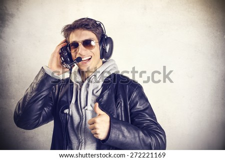 Cheerful aircraft pilot  - stock photo