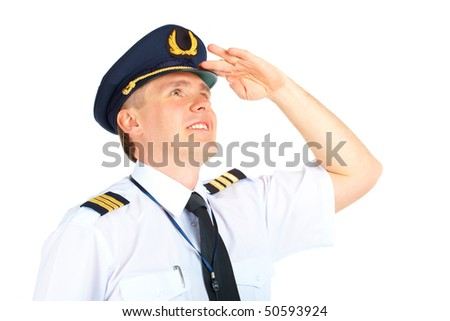 Cheerful airline pilot wearing uniform with epaulets and hat looking upwards, standing isolated on white background. - stock photo