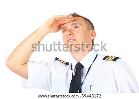 Cheerful airline pilot wearing uniform with epaulets  looking upwards, isolated on white background. - stock photo