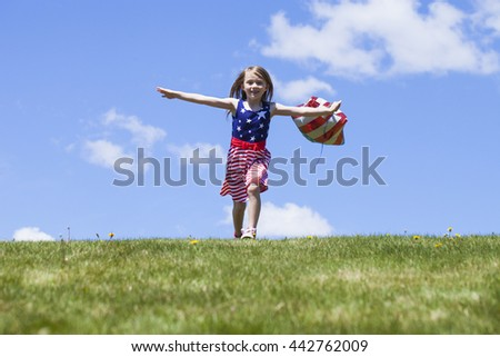 Cheerful American  girl with balloons running outside. 4th of July. Independence day.