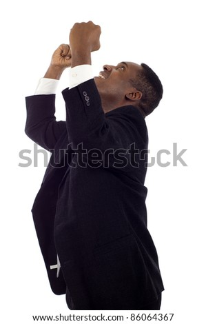 Cheerful and excited entrepreneur, African American businessman celebrating his success with arms raised and looking up isolated white background - stock photo