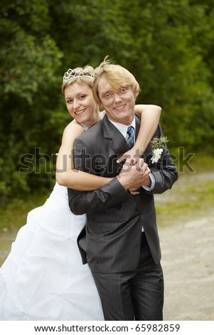 Cheerful and happy bride and groom - outdoor - stock photo