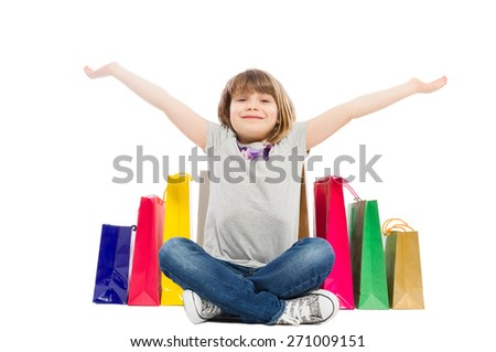 Cheerful and joyful shopping kid satisfied of presents or gifts - stock photo