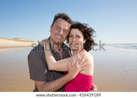 Cheerful and loving couple spendingtime together at beach