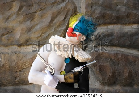 Cheerful and mischievous clown - stock photo