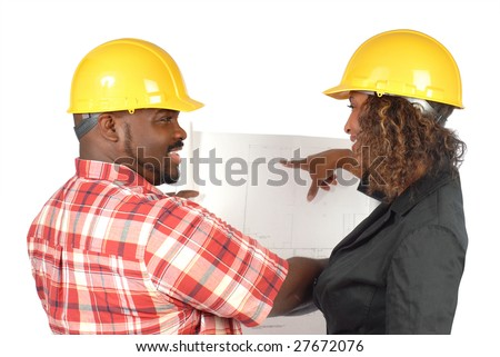 Cheerful and smiling architectural workers discussing blueprints - stock photo