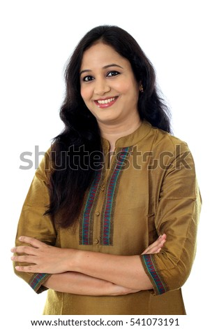 Cheerful arms crossed woman against white background