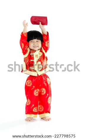 Cheerful asian boy holding a red packet. Chinese new year concept. - stock photo