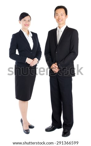 Cheerful asian businessman and businesswoman - stock photo