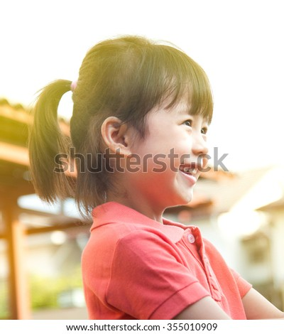 Cheerful asian girl - stock photo