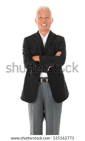 Cheerful Asian senior businessman standing isolated white background - stock photo