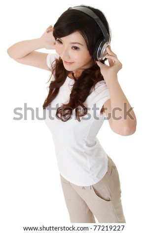 Cheerful Asian woman listen music by headphone, full length portrait isolated on white background. - stock photo