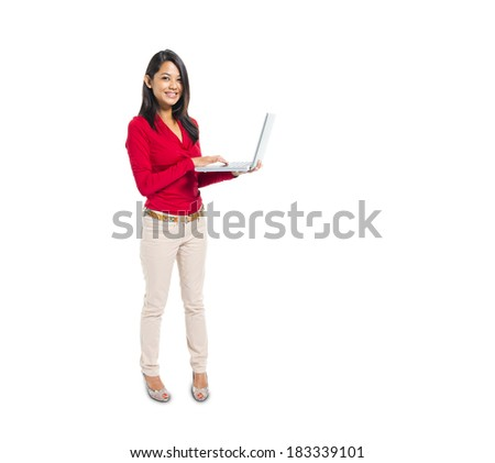 Cheerful Asian Woman Working On  Laptop - stock photo