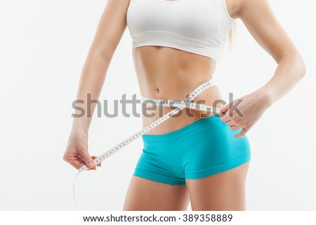 Cheerful athlete is taking measurement of figure - stock photo