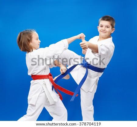 Cheerful athletes train blows and blocks karate - stock photo