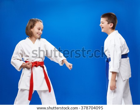 Cheerful athletes with red and blue belt - stock photo