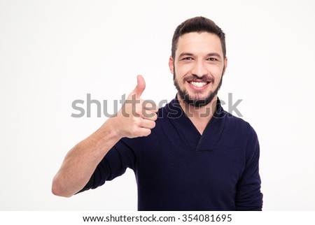 Cheerful attractive bearded man smiling and showing thumbs up over white background - stock photo