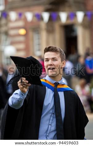 Cheerful Attractive Male Graduate Celebrating - stock photo