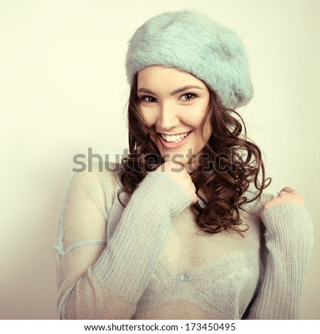 Cheerful attractive young girl smiling and looking at camera,  in warm clothes, toned - stock photo