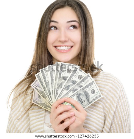 Cheerful attractive young smiling woman holding cash, dreaming and looking up over white - stock photo