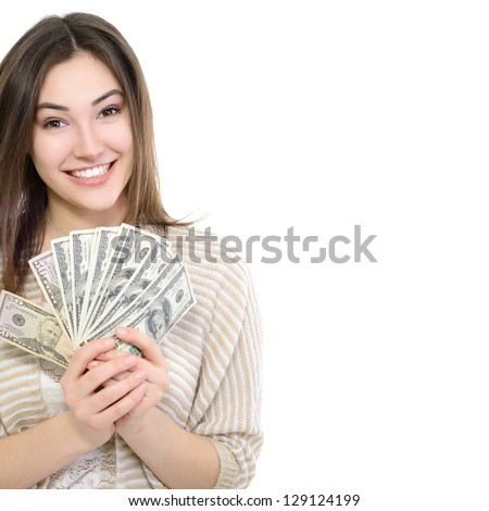 Cheerful attractive young smiling woman holding cash, over white - stock photo