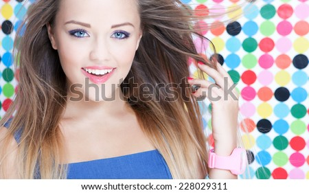Cheerful attractive young woman on spotted background, beauty and fashion concept  - stock photo