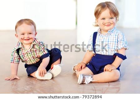 Cheerful babies playing - stock photo
