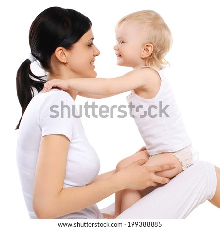Cheerful baby and mom - stock photo