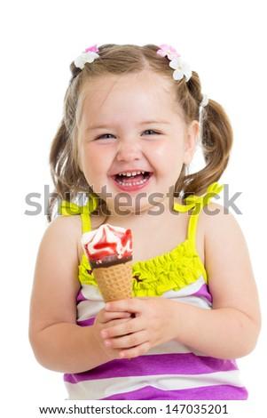 cheerful baby girl eating ice cream isolated - stock photo