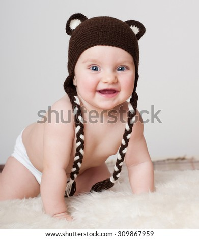 cheerful baby in the hat. Beautiful happy baby. Laughing baby. - stock photo