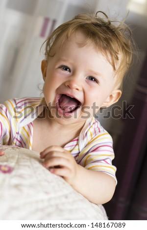 Cheerful baby laughing - stock photo