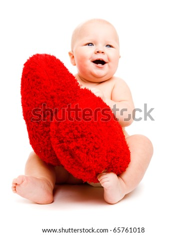 Cheerful baby playing with fluffy hearts - stock photo