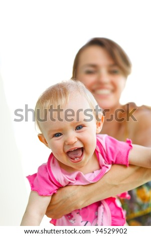 Cheerful baby playing with mother - stock photo