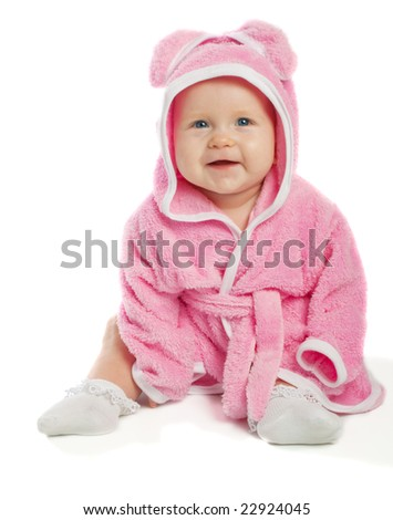 Cheerful baby sitting in pink bath gown, isolated - stock photo