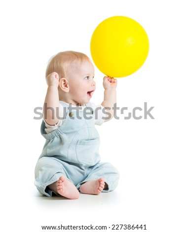 Cheerful baby with ballon in hand isolated on white - stock photo