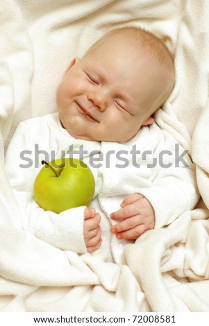 Cheerful baby with big apple - stock photo