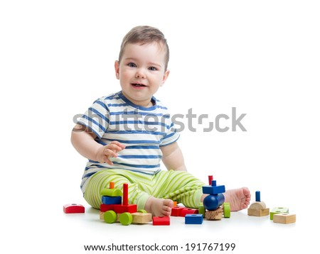 cheerful baby with construction set over white background - stock photo
