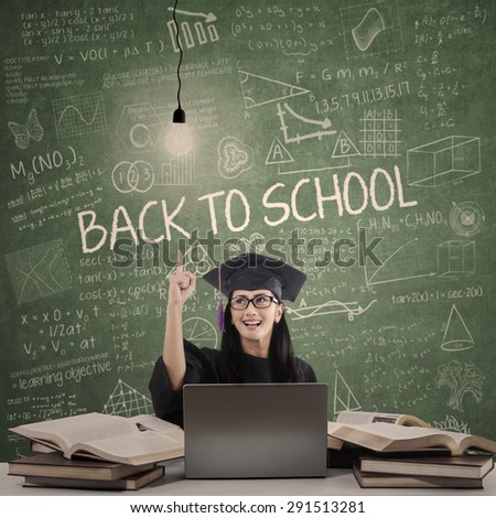 Cheerful bachelor getting idea, shot in the classroom - stock photo