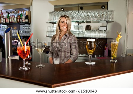Cheerful bartender behind  the counter - stock photo