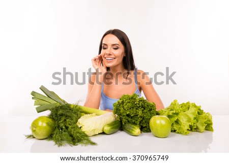 Cheerful beautiful girl on a diet with vegetables - stock photo