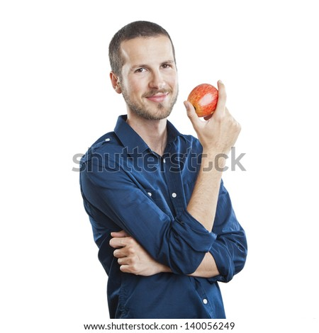 Cheerful beautiful man eating apple, isolated over white background - stock photo