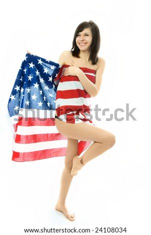 cheerful beautiful nude woman wrapped into the American flag - stock photo