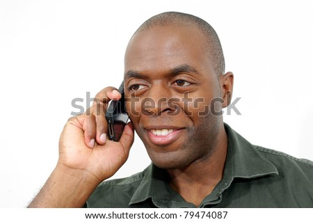 cheerful black african-american male talking on cellphone. white background.