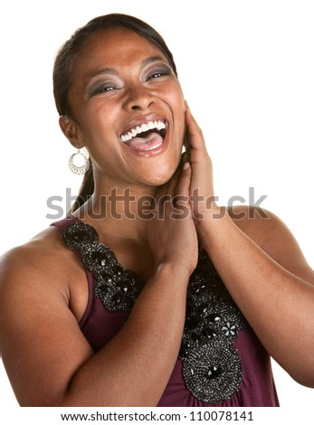 Cheerful Black woman with hands by her face laughing - stock photo